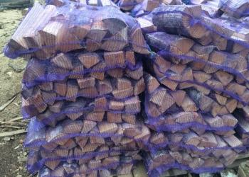 Дрова колотые березовые в сетках