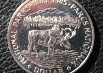 Канада. 1 доллар. 1985 г. 100 лет Национальным