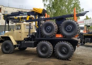 Лесовоз Урал 4320 с манипулятором прицепом роспуском