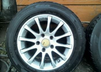 летние авто шины с литыми дисками марки dunlop размер 195х65х15
