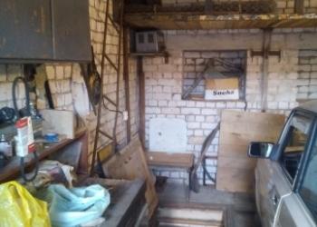 Продается кирпичный гараж в 2-х уровнях,земля и гараж в собственности